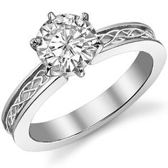 Moissanite Celtic Knot Solitaire Ring...very cool combined with the patterned band.