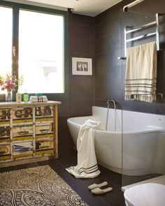 Practical Bathrooms inspiration from bathrooms: use large scale tiles, even within