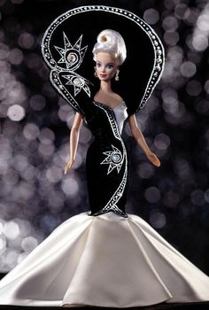 Designed by the esteemed Bob Mackie from his Jewel Essence Collection, this 1997 Barbie doll is draped in rich black velvet gown with chic white satin gathered at her feet like a flower. Description from ebay.com. I searched for this on bing.com/images