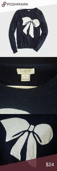 J. Crew Merino Wool Blend Navy Bow Sweater S Make an offer!  Great condition! Some lint and minor pilling.  Darling cream bow design on a navy background Crew neck, lightweight, very soft 37% viscose, 35% nylon, 28% merino wool Perfect for the holidays! True to size J. Crew Sweaters Crew & Scoop Necks