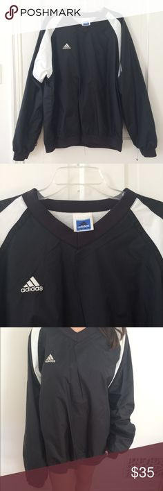 Men's Adidas vneck windbreaker Vintage vneck windbreaker by adidas. Super great quality and will definitely keep you warm. Fits oversized. Unisex adidas Sweaters V-Neck