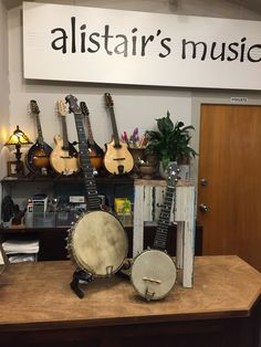 "On the left is an old English open back banjo labeled ""The Triumph"" in excellent order, just awaiting a set up. On the right a S S Stewart, Little Wonder piccolo banjo. Both circa 1890."