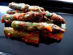 Spicy marinated asparagus - basically asparagus with chili paste, red miso and mirin.