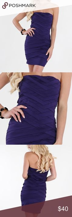 Crisscross Strapless Dress Make a first impression that lingers when you step out in this slinky grape-colored tube dress with a short hemline. The figure-enhancing polyester and spandex offers a comfortable fit, and the bold crisscross pattern draws attention to your every asset. **only worn once**  Sleeve-length: Sleeveless Material: Spandex, Polyester Style: Sheath Scoop Neck Dress Length: Mini Care Instruction: Dry Clean Color: Purple nikibiki Dresses Strapless