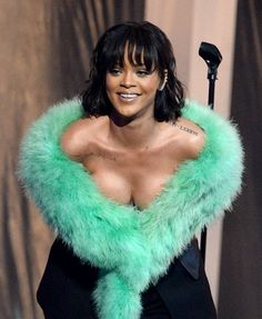 """Rihanna wowed the 2016 Billboard Music Awards tonight (May 22) with a standout rendition of """"Love on the Brain.""""  The Barbadian singer seemed to savor the performance of the throwback lounge cut, drawing out high notes and swaying with emotion during the song's chorus."""
