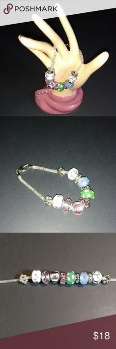 """Silvertone bracelet This bracelet has 11 removable rhinestone & glass beads that can be removed and rearranged to your specifications. It measures 8.5"""" in length. Preowned and looks new. Jewelry Bracelets"""