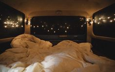 Camping in the back of the car with duvets and fairy lights - too . Road Trip Van, Camping Sauvage, Kombi Home, Album Design, Roadtrip, Adventure Is Out There, Camping Hacks, Camping Site, Camping In Car