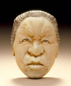 Japan  Mask Portrait of Old Woman, late 19th-early 20th century  Netsuke, Ivory with staining, sumi