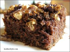 Chocolate Zucchini Cake With Butter, Vegetable Oil, Sugar, Eggs, Zucchini, Sour Milk, Vanilla, Flour, Cocoa, Salt, Baking Soda, Baking Powder, Mini Chocolate Chips, Chopped Walnuts, Brown Sugar