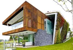 modern house design with green wall and green rooftop