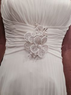 My beautiful dress n broach, matching one in my hair....hand made in California n rediculously expensive to have done! But they were dainty n delicate n perfect! They were beautiful!