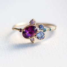 Wild Berry Jam Cluster Ring // Garnet, Tanzanite, Amethyst, Sapphire and London Blue Topaz in 14k Yellow Gold // Purple Asymmetrical Ring by MelanieCaseyJewelry on Etsy https://www.etsy.com/listing/506535059/wild-berry-jam-cluster-ring-garnet