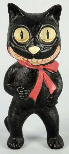 Striking vintage piece, this black cat is a celluloid Halloween rattle. #halloween #blackcats