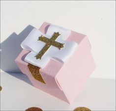 Handmade pink and gold glitter cross favor boxes for her special Baptism, Christening or First Communion celebration! Each two piece box creates elegant thank you gift packaging for your party guests!