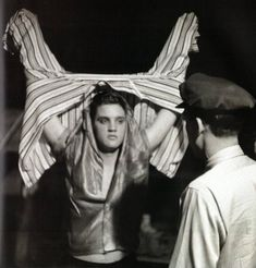 """Elvis Presley photographed backstage at the University of Dayton Fieldhouse, Dayton, OH on Sunday, May 27, 1956 by Phillip Harrington on assignment for Look magazine   Photo first published in the FTD book """"A Moment In Time: 4 Days In '56"""" (Nov. 2011)   Take a look inside the book: https://www.youtube.com/watch?v=W_aAzu1K-qg   See more: http://scottymoore.net/dayton.html"""