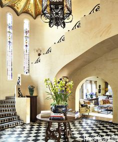 Interior designer Thomas Callaway brought warmth and romance to a 1929 Spanish Colonial Revival house in Los Angeles when he roused its icy white interior with color.