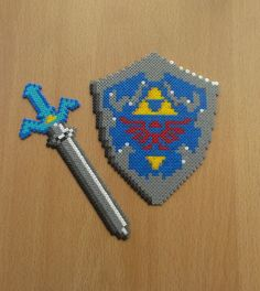 The Legend of Zelda: Ocarina of Time - Master Sword and Hylian Shield perler beads by PixelBeadPictures