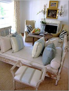 Chippy French wooden daybed - thinking that I may be able to achieve something very similar using two matching twin bed headboards that I already have in storage.  ;-)