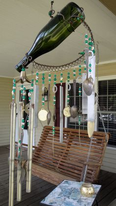 Not a bottle tree but it works for me. Wine bottle wind chimes