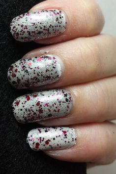 """This is a gorgeous charcoal tinted glitter top coat polish. It is packed with two shades of burgundy glitter, black and silver glitters and white bars. While I was mixing the colors in this polish, I heard Christina Aguilera's """"But I'm a good girl"""" from the movie Burlesque playing in the other room. I LOVE THAT MOVIE! The glitter colors remind me of a corset and the charcoal colored base looks like black lace stockings....so there was the name!First photo shows two..."""