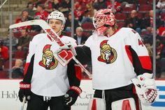 NEWARK, NJ - FEBRUARY 03: Robin Lehner #40 of the Ottawa Senators talks during a timeout with teammate Mark Borowiecki #74 during the game against the New Jersey Devils at the Prudential Center on February 3, 2015 in Newark, New Jersey. (Photo by Andy Marlin/NHLI via Getty Images)