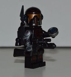 Photo courtesy of This Star Wars Bounty Hunter Custom Minifigure looks amazing and features a decal robotic arm and a communicator which notifies Lego Custom Minifigures, Lego Minifigs, Star Wars Minifigures, Lego Star Wars, Star Wars Bounty Hunter, Lego Clones, Lego People, Lego War, Cool Lego Creations