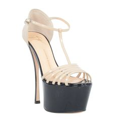 Glam up your look with these fierce and fashion-forward Giuseppe Zanotti Platform Heel T-strap Sandals. These shoes showcase a tan leather construction and 6 inch heel, 2.5 inch platform and open toe.