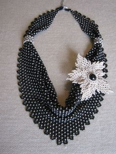 Beadwoven scarf and flower necklace by Alexandra