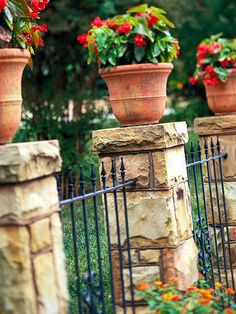 Create Old-World Charm....Alternate mortared stone columns with wrought-iron panels topped with finials for an elegant and stately fence combination. Top the stone pillars with clay pots filled with begonias or other colorful blooms for visual appeal.
