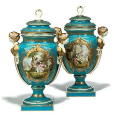 A PAIR OF SEVRES PORCELAIN TWO-HANDLED VASES  LATE 19TH CENTURY  Each painted with roses and flowers on a white reserve panel on one side and courting figures in a shaped panel to the other-side, all on a turquoise ground with gilt decoration, female mask side handles and domed covers, interlaced Sevres marks under base  17in. (43cm.) high overall (2)