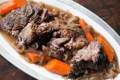 Pot Roast ~ Beef pot roast recipe, slow cooked on stove top or in oven with onion, garlic, carrots, and red wine.  Slow cooking on low heat practically ensures a tender pot roast from the tougher beef chuck or shoulder roast cut. ~ SimplyRecipes.com