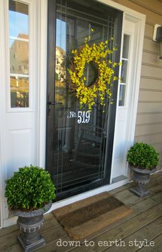 Make urn toppers & wreath on storm door (good idea) Down to Earth Style: Preserved Boxwood Makeover