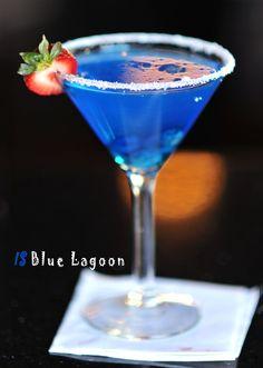 Blue Lagoon  3/4 oz apple rum   3/4 oz coconut rum   1/2 oz banana liqueur   1/2 oz Curacao   Splash of pineapple juice