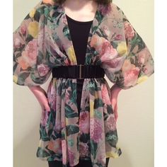 Belted Floral H&M Kimono Lovely floral kimono with a built in black belt! I've worn this maybe twice. Very flouncy. Perfect with leggings and boots, or even as a beach coverup. Tag says XS but this could definitely fit a Small(marked as Small) or even a small Medium. H&M Tops