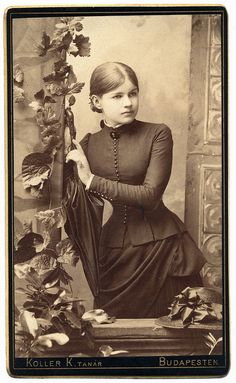 :::::::::: Antique Photograph :::::::::: Young Woman posing with a lovely studio backdrop. Budapest, Hungary 1883
