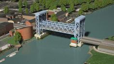 An artst's rendering of a long, verticle lift bridge to replace the Walk Bridge across Norwalk Harbor. A Connecticut Department of Transportation report says it is the peferred choise to replace the 120-year-old railbroad bridge. Photo: Contributed Photo / Contributed Photo / Norwalk Hour contributed