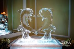 Heart shaped dolphin ice sculpture.