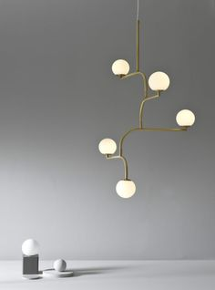 Mobil is build up by four equal parts linked to each other. Together they create a pendant lamp with graphic qualities and movement that looks interesting from all angles. Cool Lighting, Modern Lighting, Lighting Design, Pendant Lighting, Lighting Stores, Pendant Lamps, Industrial Lighting, Hanging Light Fixtures, Hanging Lights