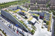 The hill-like Hangzhou Duolan Commercial Complex is part landscape, part urban design and part architecture. It provides a playful combination of housing units, public open spaces, community gardens and recreational spaces for occupants of a new district of Xia Sha in China.