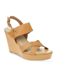 Step out in style with these Shadow Wedge Heels by Daniella Michelle. This trendy designshowcases criss-cross straps over the front of the foot, with another thinkerstrap over the back of the foot. Tan in colour, it offers an adjustable straparound the back of the ankle, while it boasts an 8.5cm wedge heel. Perfect fora variety of occasions, team these with a mini dress and clutch bag for a nightout.