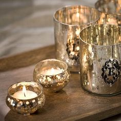I am nothing short of drooling over mercury glass at the moment! I collected lots for my Christmas decorating - it's much cheaper than it looks, it goes with sophisticated, or with rustic, or with vintage...and sparkles like nothing else!! LOVE.