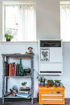"""Her biggest embarrassment is the heater. """"It's an eyesore that couldn't be cheaply avoided. Though others might not notice, I dream of a mini fireplace and make myself feel better by putting a painted metal sign on it to distract and elicit memories of my trip to Morocco."""" The orange Viper tool box was bought on Amazon."""