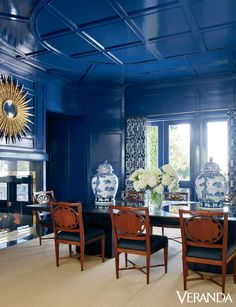 The centerpiece of Kelli Ford's blue-hued home is this gleaming cobalt blue ceiling, with paneling and trim extending onto the walls. The antique Russian chairs are from Sotheby's and in Clarence House fabric; the table is from Moura Starr. The curtains are in a China Seas fabric.   - Veranda.com