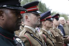Representatives of the Army London Division pay their respects to Corporal Frederick Holmes in Bermondsey.