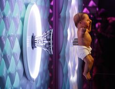 Animatronic baby London 2016, a mechanical human baby with an electronic umbilical cord is displayed, during a press preview for the Robot exhibition held at the Science Museum in London on February 7, 2017. The exhibition, which shows 500 years of mechanical and robotic advances, is open to the public form February 8 through to September 3.