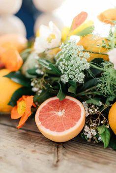 Citrus table runner from fresh fruit and flowers
