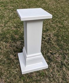 """Pair of white wooden pedestal for altar/ceremony arrangements.  Approx. 33"""" tall, with 16"""" square top."""
