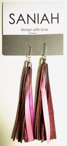Hapsu earring with burgundy coloured leather and pink satin ribbons. Made of industrial surplus and recycled materials.