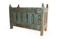 Love the worn colors on this ornate oversized wood buffet from Rajasthan.