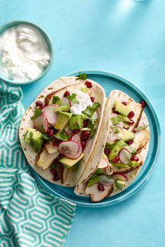 Spiced Chicken Tacos with Avocado and Pomegranate Salsa  - CountryLiving.com